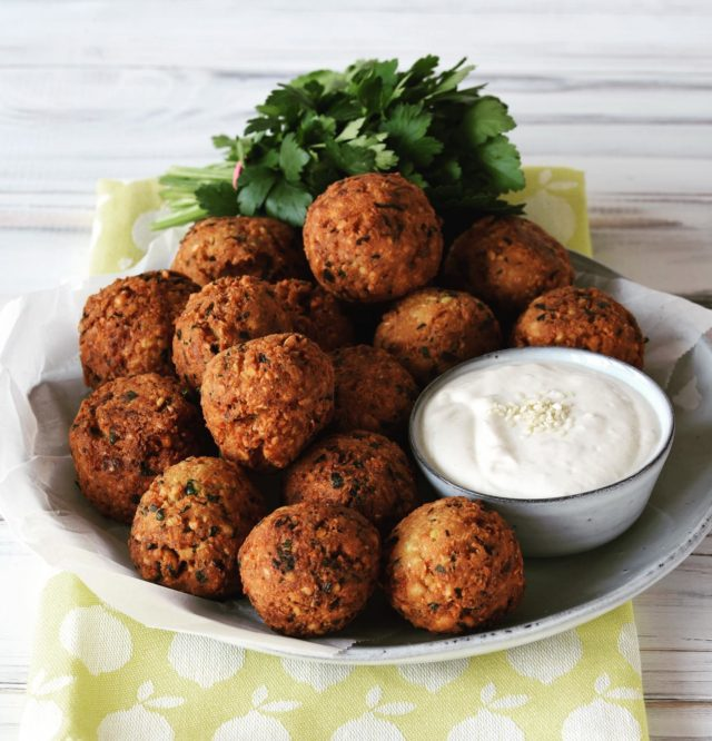 Hands up if you love FALAFEL!   ⬇️Scroll down for the recipe ⬇️  This recipe is the real deal with raw, soaked chickpeas. This is the only way the falafel get crispy on the outside and soft in the inside. You'll never go back to the awfully mushy falafel you get from cooked chickpeas from a tin, I promise! You only need a handful of ingredients, most of the you have already at home. They only difficult thing is to remember to soak the chickpeas the day before. But that's pretty easy now that we are all home so much anyway, right? And if you dislike the frying part, I have a oven baked variation for you at the end of the recipe.  🍽 We'll enjoy the falafel tonight with a tahini yoghurt sauce, oven baked beetroot salad and wholemeal flatbread. But of course you could also serve them in a pita, on top of a salad, and, and, and.   ❓What's your favorite way to serve falafel? Please comment and give me some new ideas.   250 g dried chickpeas 1 small onion 2 cloves of garlic 1/2 bunch flat parsley 1 tsp salt 1/2 tsp each grounded cumin and coriander  1/2 tsp baking powder 1 heaped tbs flour Oil for frying  Soak chickpeas on water for at least 12 hours.   Finely diced onion and garlic. Finely chop parsley.   Drain chickpeas and shred in a good processor. Add all other ingredients and 2-3 tbs water and knead until we'll combined.  Wet your hands and form the chickpea dough into 16 balls (ping pong ball size).   Heat oil in a wide pot. The temperature is right when little bubbles form at an immersed wooden stick. Add falafel in portions of 4-6 and fry 5-8 minutes. Turn the falafels during the process. Drain on kitchen paper.   Don't want to fry them? Then brush raw falafel with a little bit of oil, put on a lightly oiled baking sheet and bake 25 minutes at 200 *C. Turn after 15 minutes.  • • • • • • #falafel #INGAcooks #homemadefalafel #plantbasedfood #newrecipe #healthyrecipe #veganrecipe #ilovepulses #instafood #chickpeas #chickpealoved #plantprotein #fiberrich #happyfood #falafellove #falafeltime #plantbased #yummybuthealthy  #instayum #falafelrecipe #falafelfromscratch #plantbasedrecipe